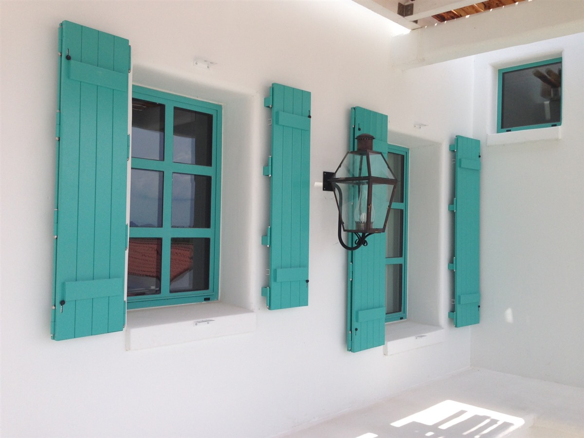 Colonial fortified shutters inc for Exterior window weather protection